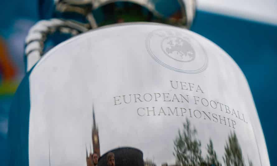 Kings Cross Station in London is reflected in the European Championship trophy during preparation for the continental tournament.