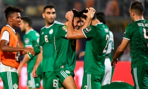 Algeria players celebrate after their victory.