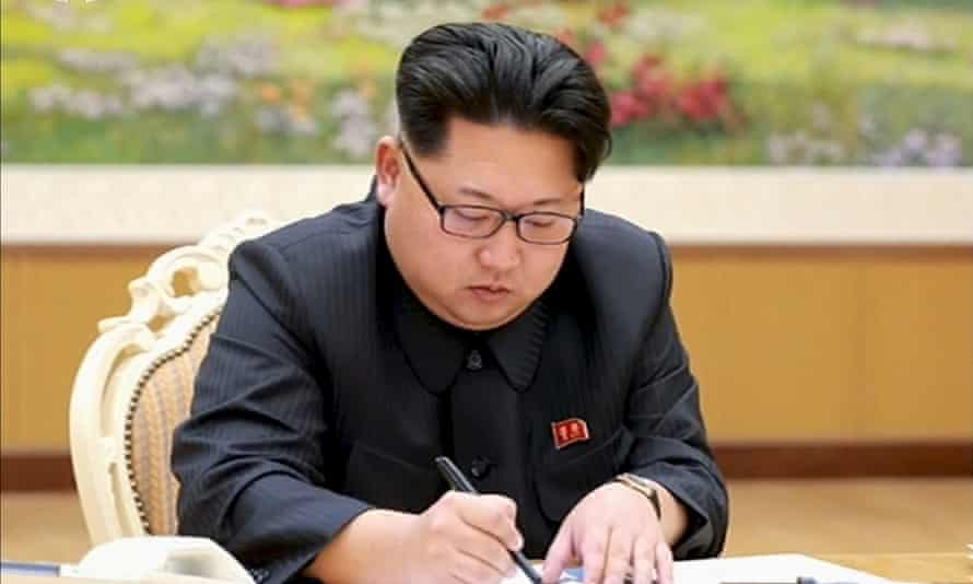 North Korean leader Kim Jong-un signs a document regarding the test of a hydrogen bomb in January 2016.