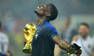 Paul Pogba celebrates with the trophy.
