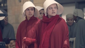 Nina Kiri and Elisabeth Moss in The Handmaid's Tale.