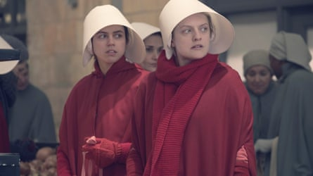 Nina Kiri and Elisabeth Moss in The Handmaid's Tale.