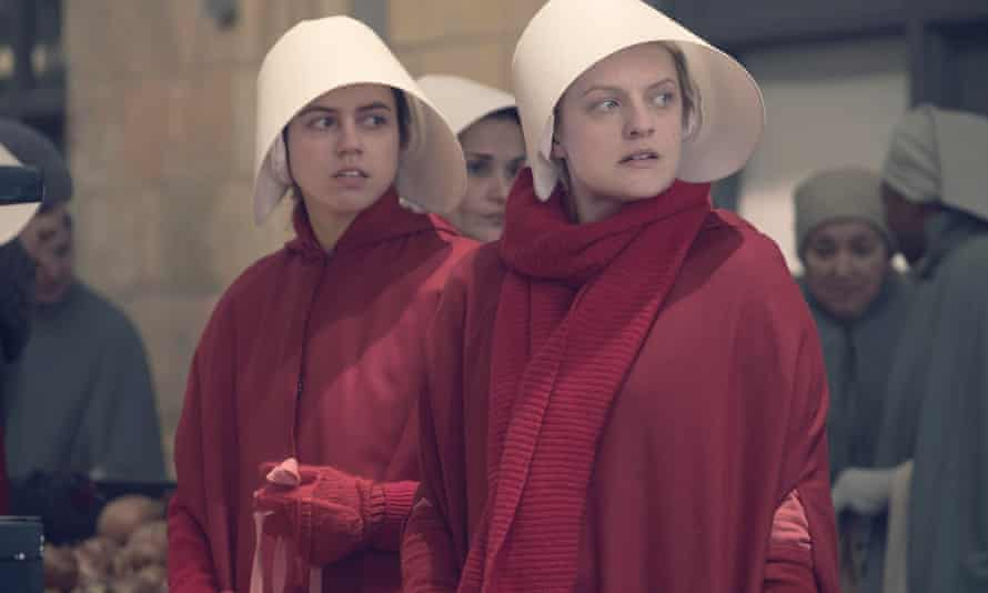 Ofrobert played by Nina Kiri and Offred played by Elisabeth Moss