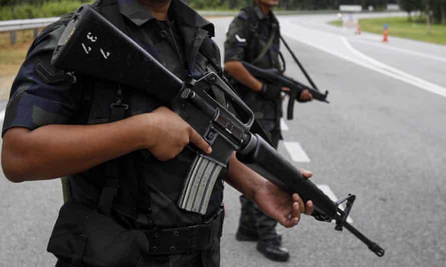 Malaysian Police stand guard