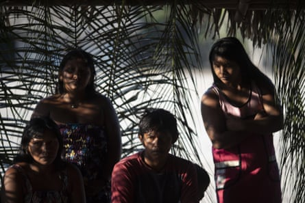 Members of the Kayapo indigenous group attend a meeting to discuss community issues in Bau village located on Kayapo indigenous territory in Brazil's Amazon