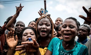 Supporters of Felix Tshisekedi celebrate outside the Union for Democracy and Social Progress (UDPS) headquarters in Kinshasa on Thursday.