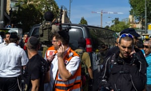 Israeli security forces attend the scene of a stabbing attack in Jerusalem.