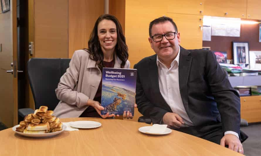 New Zealand prime minister Jacinda Ardern and finance minister Grant Robertson pose with the 2021 Budget paper