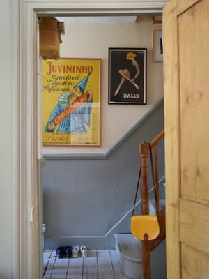 Vintage posters lining a hall and stairwell.