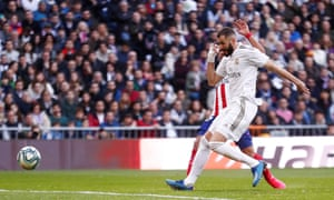 Real Madrid's Karim Benzema scores their first goal.