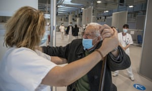 Antonio Garcia, 95, dances with a health worker before being vaccinated with the Moderna vaccine during a Covid-19 vaccination campaign at the Nurse Isabel Zendal Hospital in Madrid, Spain.