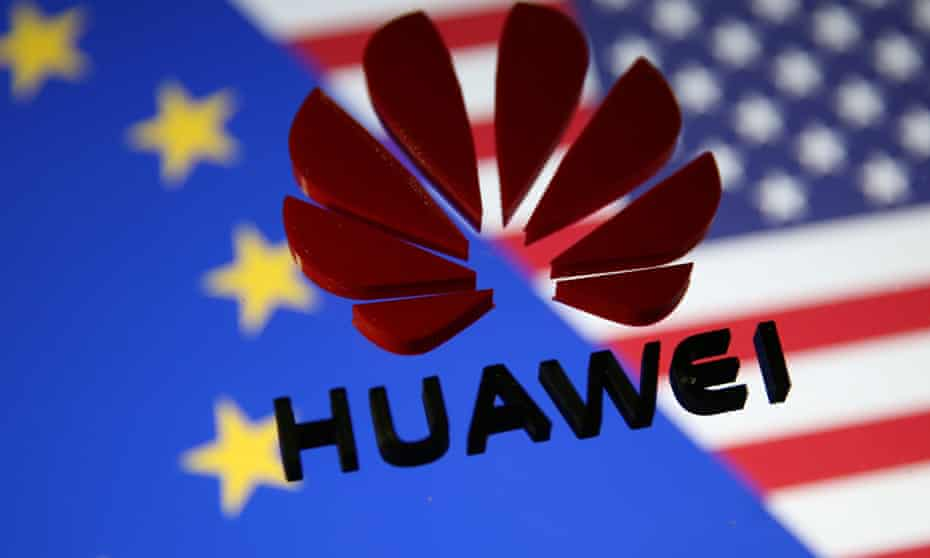 Huawei logo against EU and US flags