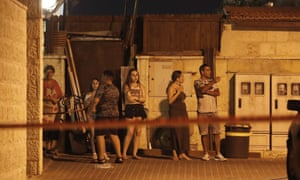 Israelis at the scene of the stabbing attack at the Adam settlement in the occupied West Bank.