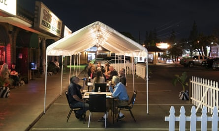 People dine at outdoor accommodations at a restaurant in La Habra, California.