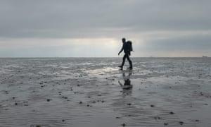 man walking on mud, Foulness, Essex
