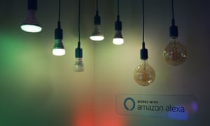 a selection of smart bulbs hanging from flexes in a dimmed space