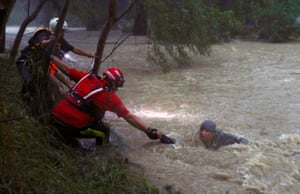 Guadalupe, MexicoRescue workers save a man who is in difficulty from the strong currents of La Silla river during Tropical Storm Fernand in Nuevo Leon state.