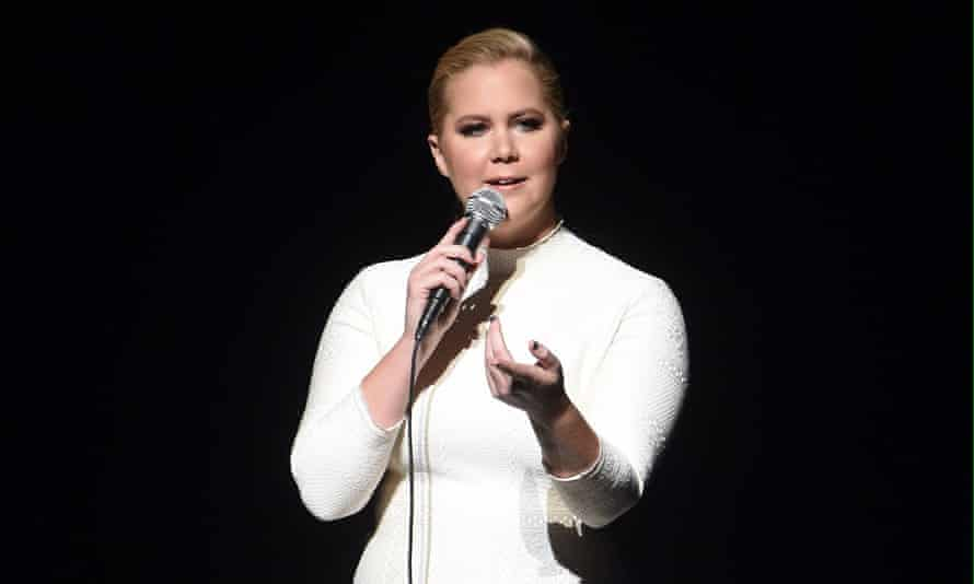 Amy Schumer with mic during an evening with Jerry Seinfeld and Amy Schumer