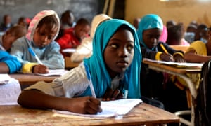 Pupils attend a primary school class in Pikine, on the outskirts of Dakar
