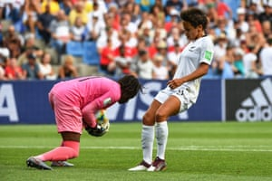 Cameroon's goalkeeper Annette Ngo Ndom gathers the ball before New Zealand's forward Sarah Gregoriuscan get to it.