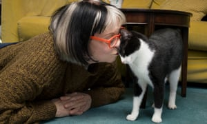Philippa Perry lying on the floor kissing Kevin's head as he nuzzles against her face.