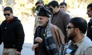 Ashraf Ghani is escorted by bodyguards in Kandahar