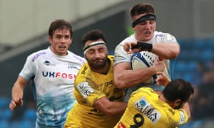 Tom Curry is tackled by Jeremy Sinzelle and Alexi Bales during the Champions Cup match between Sale and La Rochelle.