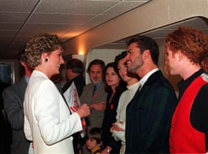Princess Diana talks to George Michael (second right) as Mick Hucknall looks on ahead of a concert at London's Wembley Arena to mark World Aids Day on 1 December 1993.