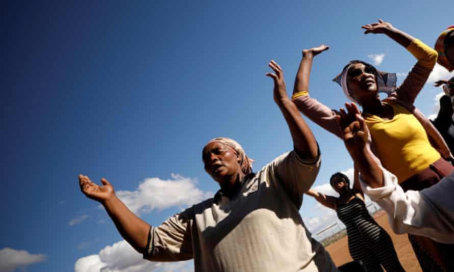 Women pray for rain during an interdenominational service in drought-stricken Graaff-Reinet, South Africa, 17 November 2019.