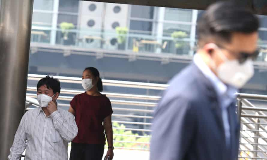 Residents of Bangkok, Thailand, wear masks to protect themselves against pollution.