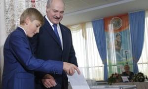 Alexander Lukashenko lets his son Kolya cast his ballot in Sunday's election.