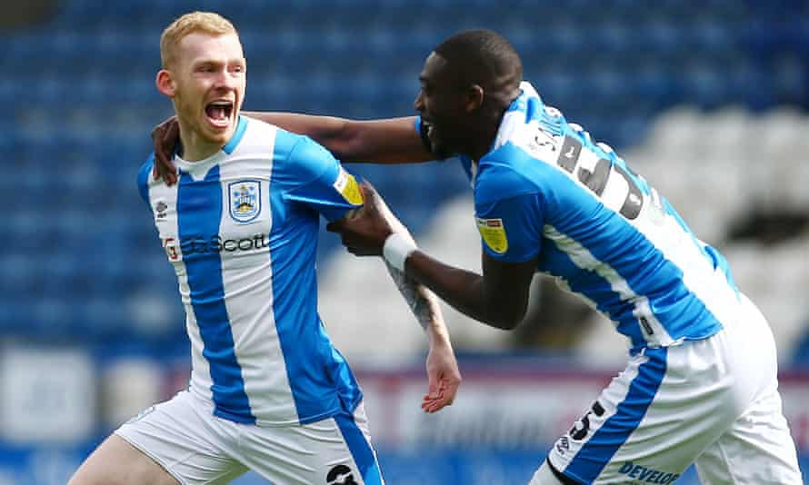 Huddersfield's Lewis O'Brien celebrates after capitalising on Brentford's defensive mix-up.