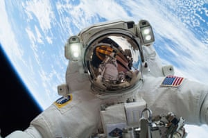 NASA handout of astronaut Hopkins, participating in the second of two spacewalksAstronaut Mike Hopkins, Expedition 38 Flight Engineer, is shown in this handout photo provided by NASA as he participates in the second of two spacewalks which took place on December 24, 2013, released on December 27, 2013. The scheduled spacewalks were designed to allow the crew to change out a faulty water pump on the exterior of the Earth-orbiting International Space Station. He was joined on both spacewalks by NASA astronaut Rick Mastracchio, whose image shows up in Hopkins' helmet visor. REUTERS/NASA/Handout via Reuters (UNITED STATES - Tags: SCIENCE TECHNOLOGY TPX IMAGES OF THE DAY) ATTENTION EDITORS - THIS IMAGE WAS PROVIDED BY A THIRD PARTY. FOR EDITORIAL USE ONLY. NOT FOR SALE FOR MARKETING OR ADVERTISING CAMPAIGNS. THIS PICTURE IS DISTRIBUTED EXACTLY AS RECEIVED BY REUTERS, AS A SERVICE TO CLIENTS - GM1E9CR1UKR01