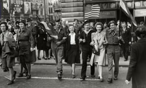 People celebrating VE Day on 8 May 1945 at the corner of Piccadilly and Regents Street in London.