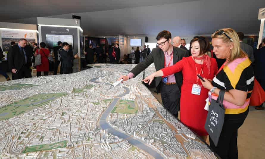 Investors examine a scale model of London at Mipim, the real estate trade show in Cannes on 14 March 2017.