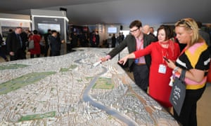 Visitors look at a scale model of London at the Mipim property conference in Cannes.