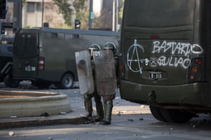 Police use shields to protect themselves in Santiago