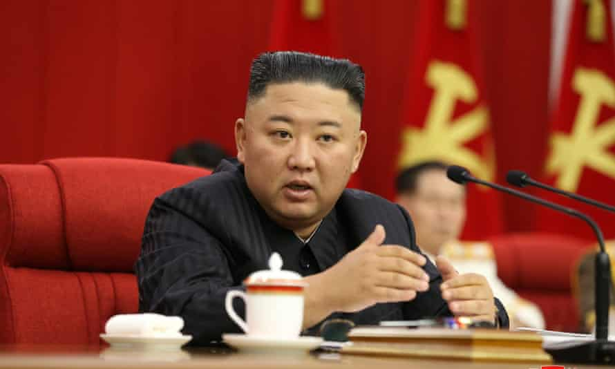 Kim Jong-un at a party meeting in Pyongyang on Thursday where he said North Korea must 'protect the dignity of our state'.