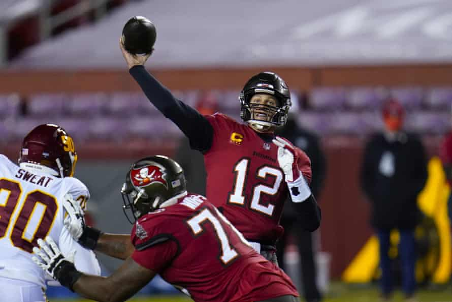 Tampa Bay Buccaneers quarterback Tom Brady launches a touchdown pass to wide receiver Antonio Brown during their NFL wild-card playoff game against the Washington Football Team in January.