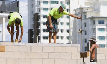 Workers on a building site in Darwin. Australia is currently re-evaluating its migration program.