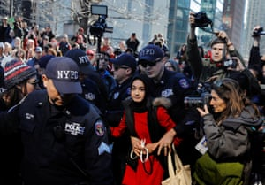 New York, USA young woman is arrested in New York after staging a sit in protest while taking part in the Day Without a Woman