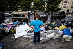 Rome, Italy A child looks at the garbage that occupies the sidewalk in the Quartaccio suburb. The closure for maintenance work of some waste-treatment plants created last week new difficulties to the deal with treatment of urban garbage