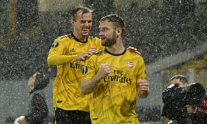 Arsenal's captain for the evening, Rob Holding, celebrates with goalscorer Shkodran Mustafi after the latter gave the English side the lead.