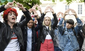 Women demonstrate against sexual harassment outside the French parliament.