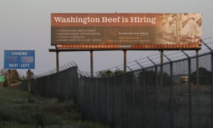 A billboard advertises job hiring at Agri Beef's plant in Toppenish, Washington. Donald Trump last month declared such plants to be critical to the US economy.