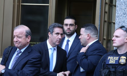 Michael Cohen, second left, leaves court in New York.