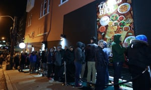 People braved the cold to line up to purchase cannabis at the Tweed retail store.