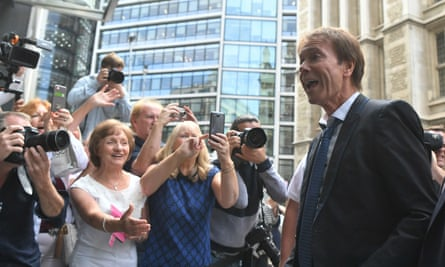 Cliff Richard arrives at the Rolls Building in London to hear the ruling of his privacy case against the BBC on Wednesday