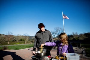 Justin Wrangler, the executive chief at Jackson Family Wines, and his daughter Delanie, nine, cook pasta with truffles, butter and cheese in Santa Rosa.