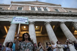 Protesters stand on the parliament as they take part in a rally demanding that Greece remains in the Eurozone, in Athens, Greece, 18 June 2015.